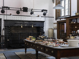 The Kitchen looking towards the roasting spits and fire at Lanhydrock, Cornwall