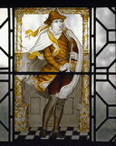 Painted glass by C E Kempe representing Winter and illustrating the passage from William Morris'