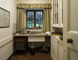 The Butler's Pantry with the sink and crockery cupboard at Coleton Fishacre, the house designed in 1925 for Rupert and Lady Dorothy D'Oyly Carte at Kingswear, Devon