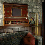 Billiard score-board and cues in The Billiard Room at Wightwick Manor,  above the sofa with Mille Fleures material designed by J H Dearle