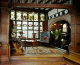 The Hall Alcove at Wightwick Manor showing the fireplace, desk and painted windows by C E Kemp dated 1888
