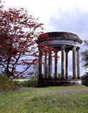 The Rotunda at Petworth surrounded by bluebells with rolling landscape in the background