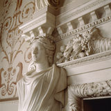 Close-up detail of a Karyatid supporting the elaborate chimneypiece in the Dining Room at Nostell Priory