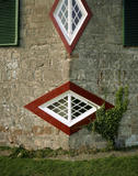 Detail of two diamond windows on a corner of the house at A La Ronde, in Devon