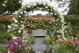 View through the arch, and bench in the Rose Garden at Mottisfont Abbey, Hampshire