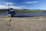 Boat on the estuary bed at low tide, at Alnmouth, Northumberland
