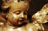Close view of a gilded wooden cherub, Italian, C18th, in Dragon at Snowshill Manor