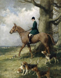 Portrait of Esme Jenner out hunting on horseback with hounds