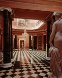 The Hall at Mount Stewart, with double pairs of Ionic columns classical nudes at either end (probably Venus and Eurydice) signed by Lawrence Macdonald and carved in Rome in 1856
