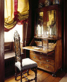 A close up of a chair and writing desk and cabinet in the Closet