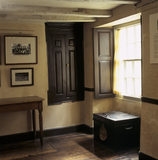View of a room in the W.M.Heelis Offices, now the Beatrix Potter Gallery at Sawrey showing a window and a cupboard in the wall.