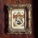 (FL) A framed drawing of the Potter coat of arms hangs to the left of the Parlour window at Hill Top