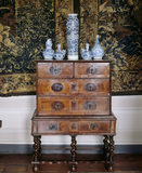 A detailed close up of a chest on stand, of walnut and tortoiseshell, c