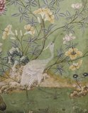 A detailed close up of wallpaper at Erddig showing a crane and some blossom
