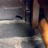 Close shot of a mousehole under the door at Hill Top, Beatrix Potter's home in Sawrey, Cumbria
