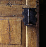 Part of the W.M.Heelis Offices, now the Beatrix Potter Gallery at Sawrey, showing an iron door handle on an old wooden door.