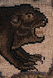 The head and fore-legs of a beaver from a motif on the Marian Needlework at Oxburgh Hall