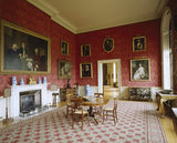 Room view of the Smoking Room at Ickworth with white marble chimneypiece of 1826-27 on left of frame