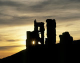 The ruins of Corfe Castle in spectacular silhouette