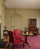 View of the Drawing Room towards the door, round table and red upholstered chairs, at Wordsworth House, home of the Wordsworth family in the 1770s