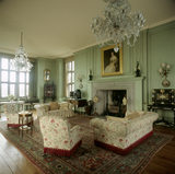 The Drawing Room at Castle Drogo, towards the open fireplace, over the chintz-covered sofa