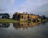 View of the West Front of Charlecote from the Camp Ground across the River Avon, with the house reflected in the river