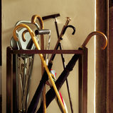 A collection of walking sticks in the hallway at Chartwell