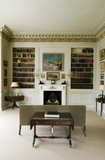 The Morning Room looking towards the fireplace by Bossi and book shelves at Mottisfont Abbey, Hampshire
