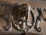 Carved head of an elephant in the oak panelling in the Dining Room at Coughton Court, Warwickshire