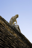 A stone monkey sits atop the West gable of the fifteenth-century Great Chalfield Manor, Wiltshire, above the priest's apartments