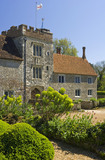 The West Front and Gatehouse Tower at Ightham Mote, Sevenoaks, Kent, a fourteenth-century moated manor house, from the garden