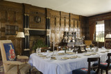 The Dining Room with sixteenth-century panelling at Coughton Court, Warwickshire