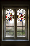 Stained glass window with roundels in the Saloon at Coughton Court, Warwickshire