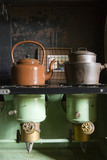Kettle and saucepans on a Valor paraffin stove, which were commonly used in rural areas with no electricity, in the Kitchen at Plas yn Rhiw, Pwllheli, Gwynedd