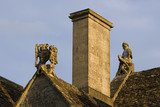 Griffin holding the Tropnell family arms, and a soldier gable ends on the roof at the fifteenth-century Great Chalfield Manor, Wiltshire