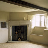 The Study at Woolsthorpe Manor showing the fireplace, window and carved wall cupboard door; the room was used by Isaac Newton when visiting his mother and contained many of his books
