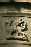 Relief of a winged dragon on the stonework at Mount Stewart Garden in Northern Ireland