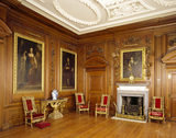 The fireplace in the Saloon at Belton House showing paintings & Gibbons style wood carvings