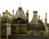 Roofscape of Tyntesfield taken from the north side of the Victorian Gothic Revival house designed by John Norton between 1863 and 1866 in tinted Bath Stone