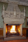 The monumental Gothic fireplace at Tyntesfield designed by Norton for the Staircase Hall, with statues symbolising Fortitude, Temperance, Justice and Prudence