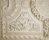 Close view of curlicue plasterwork on the dining room ceiling at Dunster Castle, installed in 1861 by Colonel Francis Luttrell (1659-90) and his wife, Mary
