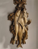 A carving by Grinling Gibbons in the Drawing Room, over the chimneypiece