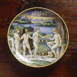 A close-up of a Maiolica dish, Castel Durante, c.1524-6 in the showcase in the Drawing Room at Polesden Lacey.