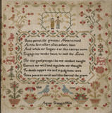 Early 19th-century embroidery sampler by Agnes Grange featuring a pious verse by the Rev. John Newton, in the Grey Lady's Chamber at East Riddlesden Hall.