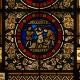 A roundel from a stained glass window by Thomas Willement in the Great Hall at Penrhyn Castle, showing the month December