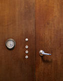 Detail of the door handle, lightswitches and clock built into the wall of the Living Room at 2 Willow Road