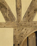 Detail of timber frame over the entrance of Alfriston Clergy House, showing the intersection of timber above the pointed arch of the doorway