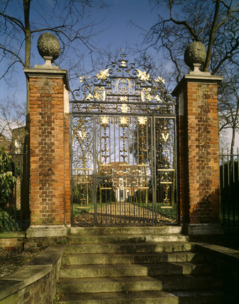 The wrought iron Front Gates at Fenton House with initials of Joshua and Anna Gee who lived there from 1706-1730, with House in background