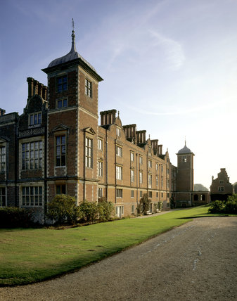 Blickling, the west front of the red brick house built 1616-24 for Sir Henry Hobart with path & lawn in the foreground