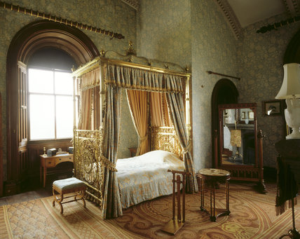 the keeps bedroom at penrhyn castle showing the brass bed